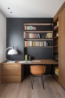 The black studio wall in House A326 stands out against the rest of the home's palette of white and concrete. Almost all of the furnishings were custom-designed by Studio DiDeA and realized by local artisans.