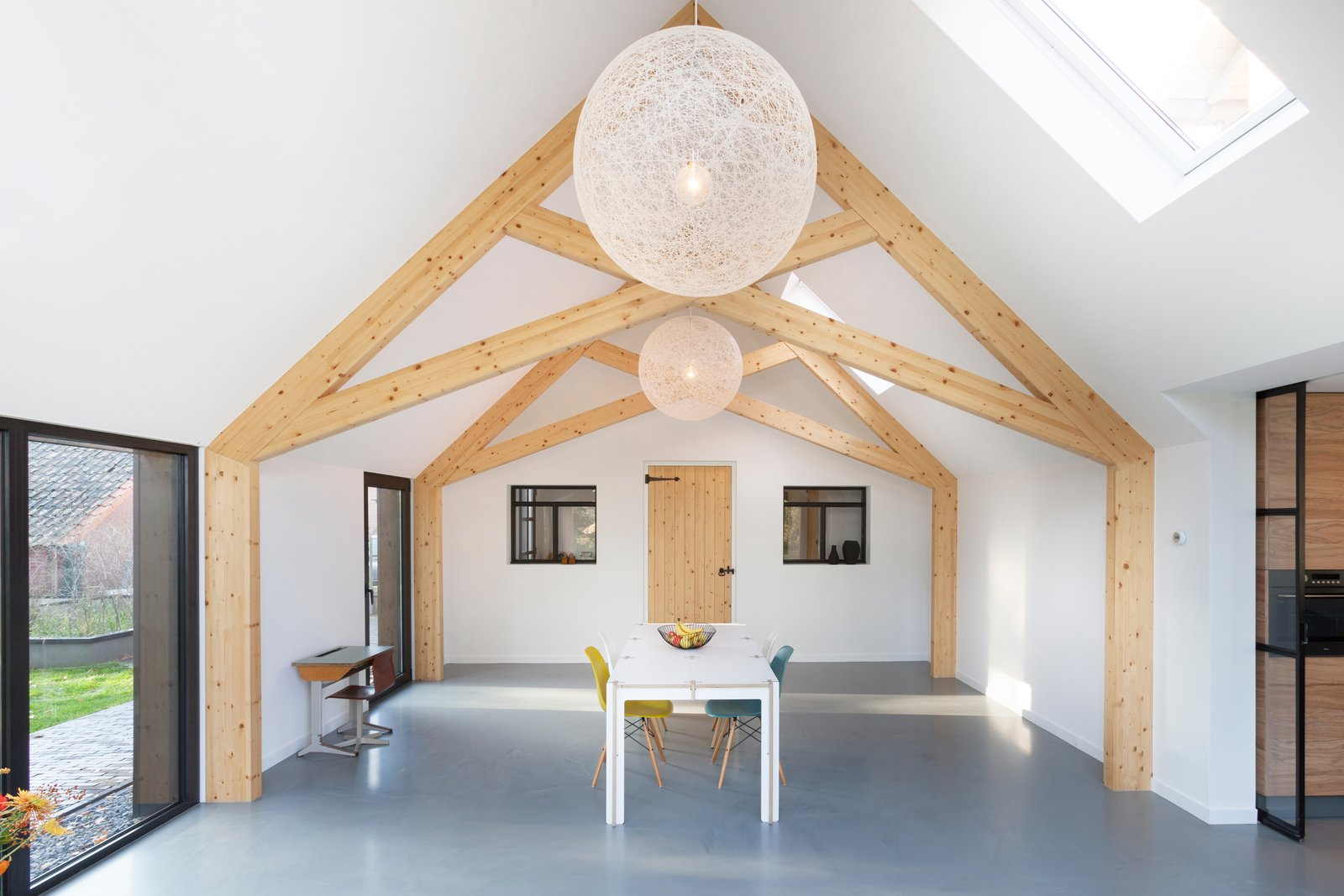 Dining Room, Ceiling Lighting, Concrete Floor, Chair, and Table  Barn Living