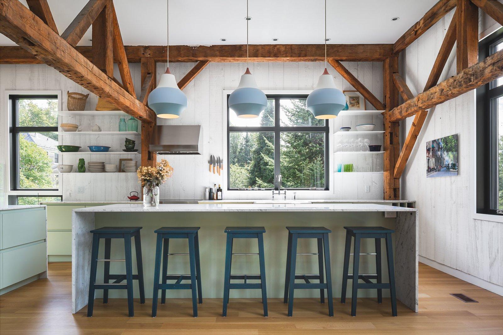 Marble Counter, Pendant Lighting, Cooktops, Range, Vessel Sink, Recessed Lighting, Colorful Cabinet, Wood Backsplashe, Kitchen, and Medium Hardwood Floor  The Barn