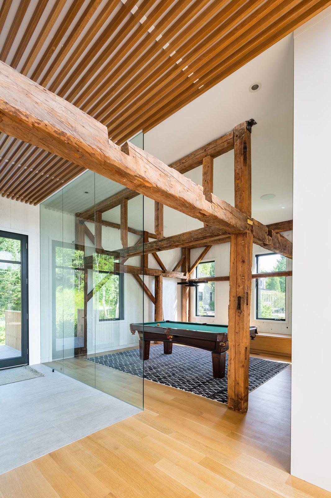 Living Room, Bench, Ceiling Lighting, and Medium Hardwood Floor  The Barn