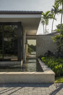 Touzet Studio's  Design for This Hammock Lakes Home Immerses Nature and Luxury