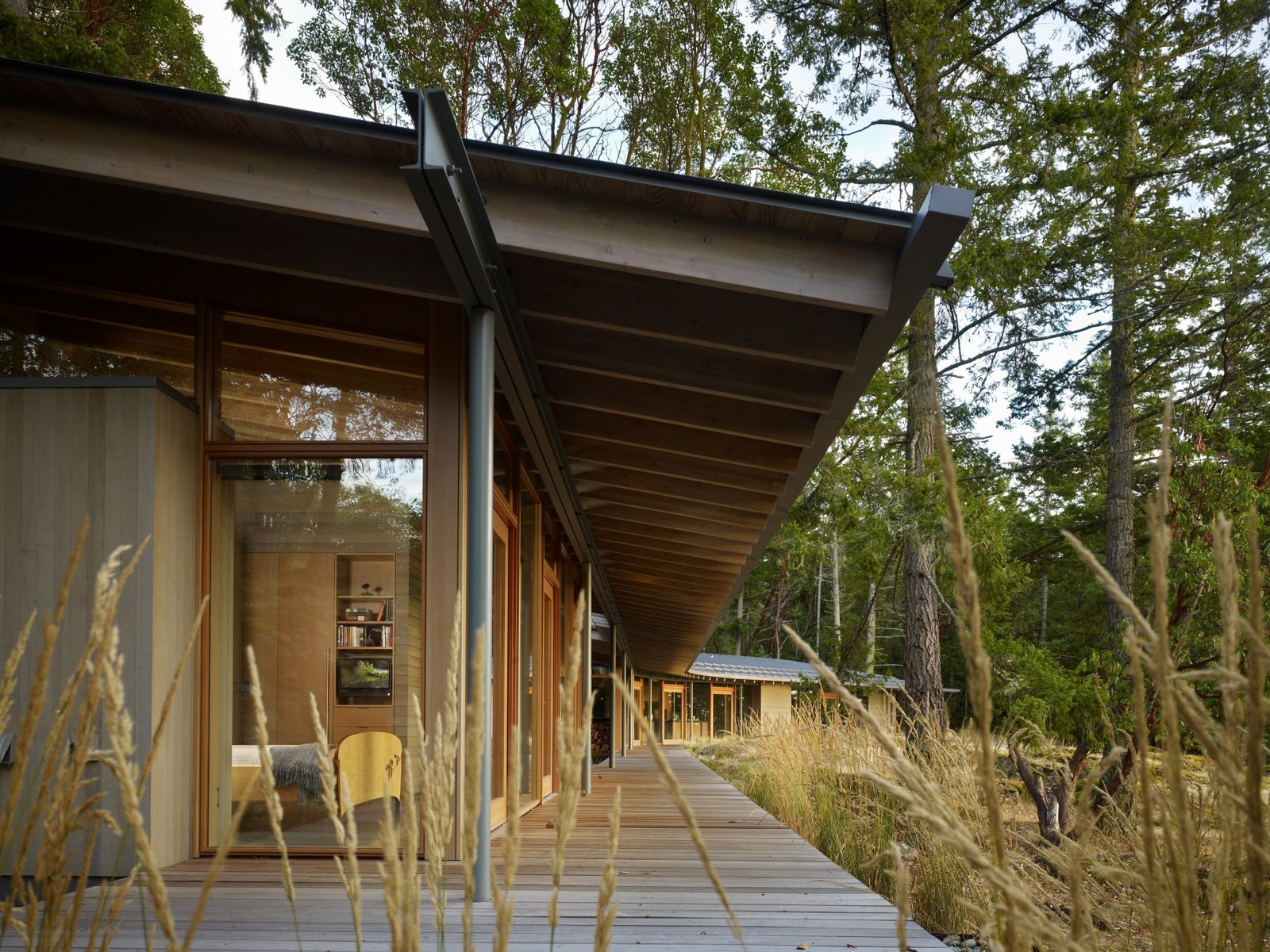 Exterior, Metal Roof Material, House Building Type, Cabin Building Type, Shed RoofLine, Concrete Siding Material, and Wood Siding Material  Suncrest Residence by Heliotrope Architects