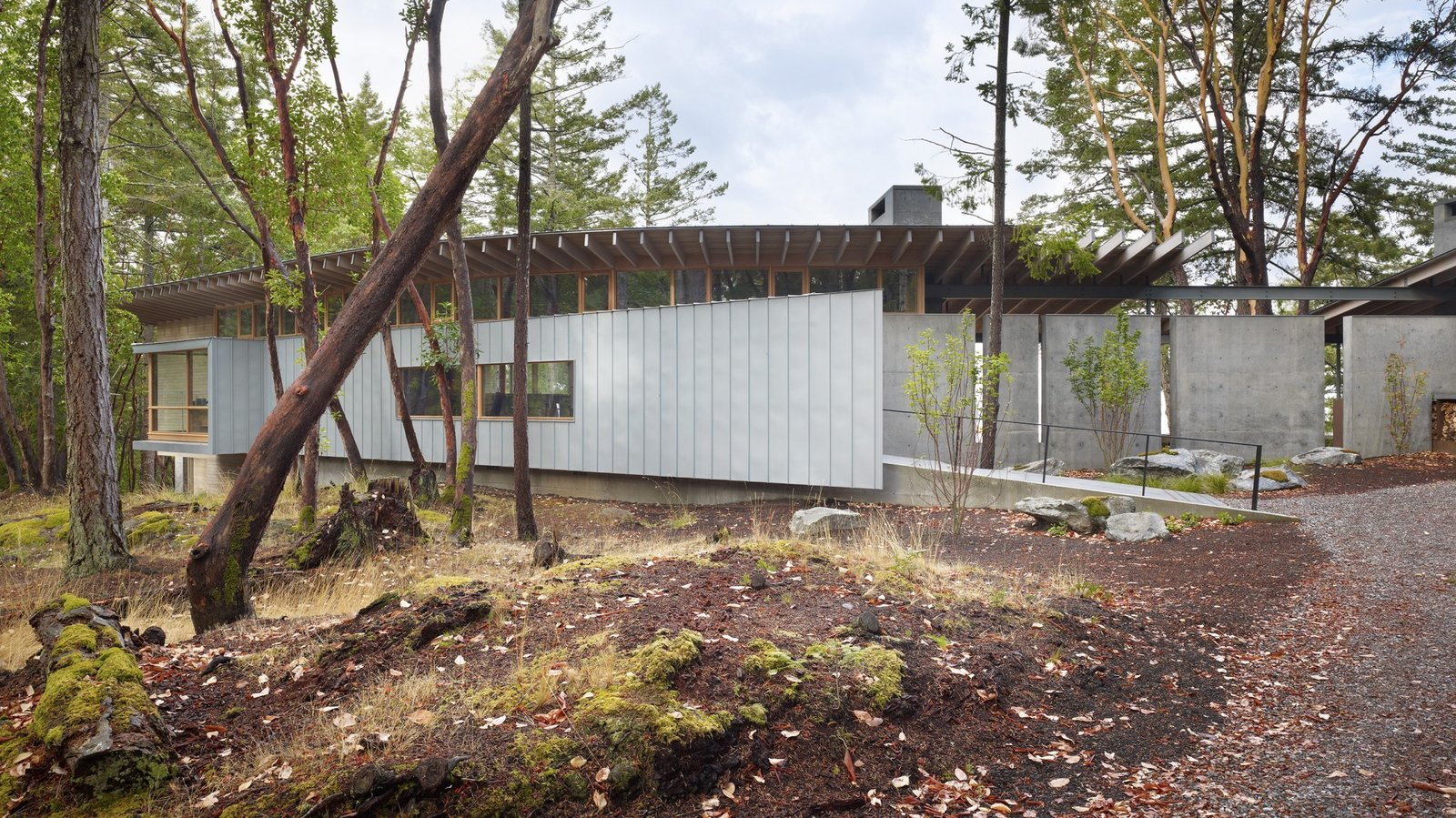 Exterior, Glass Siding Material, Cabin Building Type, Concrete Siding Material, Shed RoofLine, Metal Siding Material, Wood Siding Material, House Building Type, and Metal Roof Material  Suncrest Residence by Heliotrope Architects