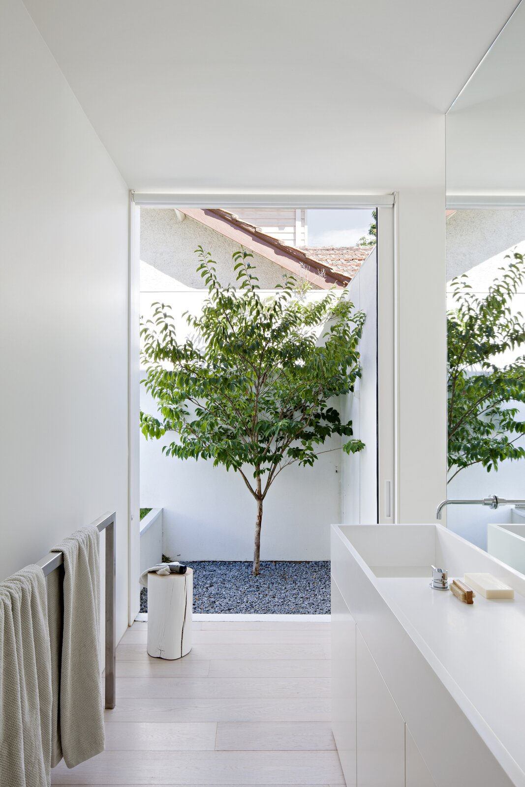 Bath Room, Ceiling Lighting, and Light Hardwood Floor  Photo 3 of 6 in An Introspective Home in Melbourne Offers Garden Views at Every Turn