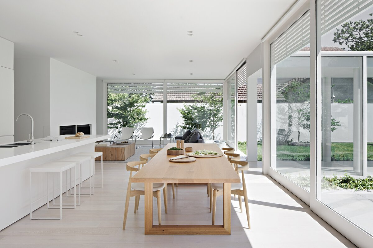 Dining Room, Ceiling Lighting, Table, Storage, Chair, and Light Hardwood Floor  Photo 2 of 6 in An Introspective Home in Melbourne Offers Garden Views at Every Turn