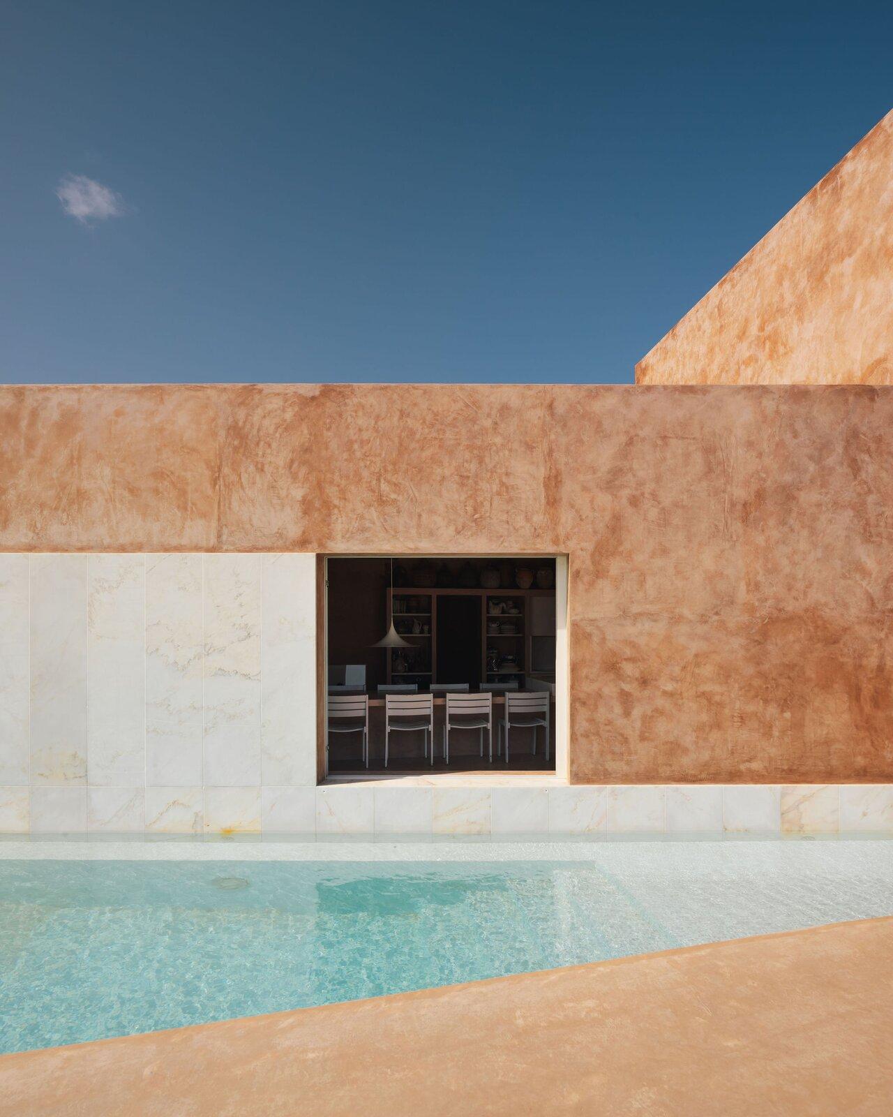 Casa Azul by Bak Gordon Arquitectos dining room and pool area
