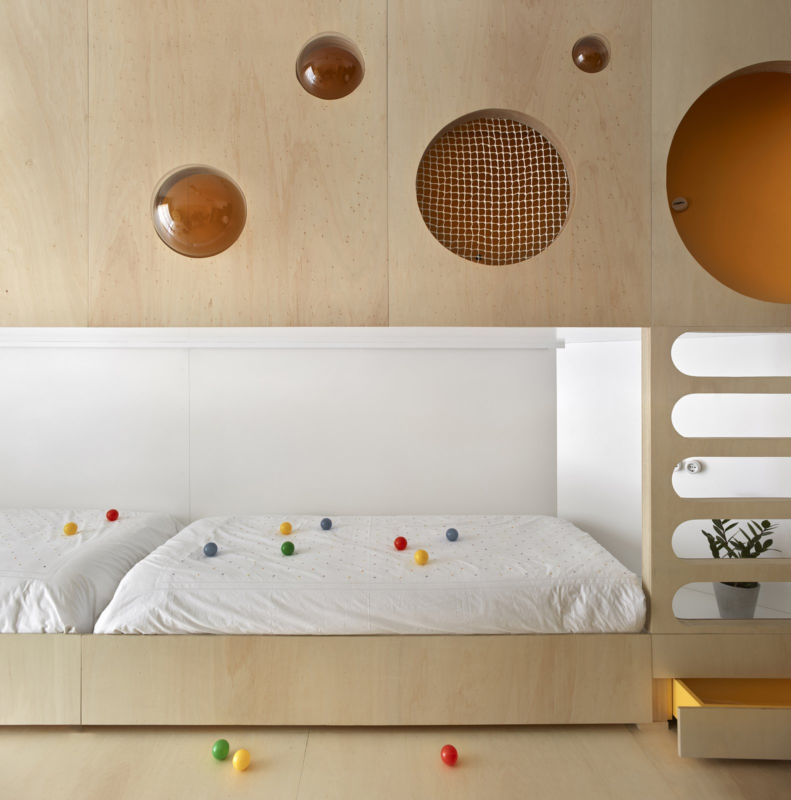 Kids Room, Playroom Room Type, Bedroom Room Type, Toddler Age, Neutral Gender, Bed, and Light Hardwood Floor  Photos from The Toy Box