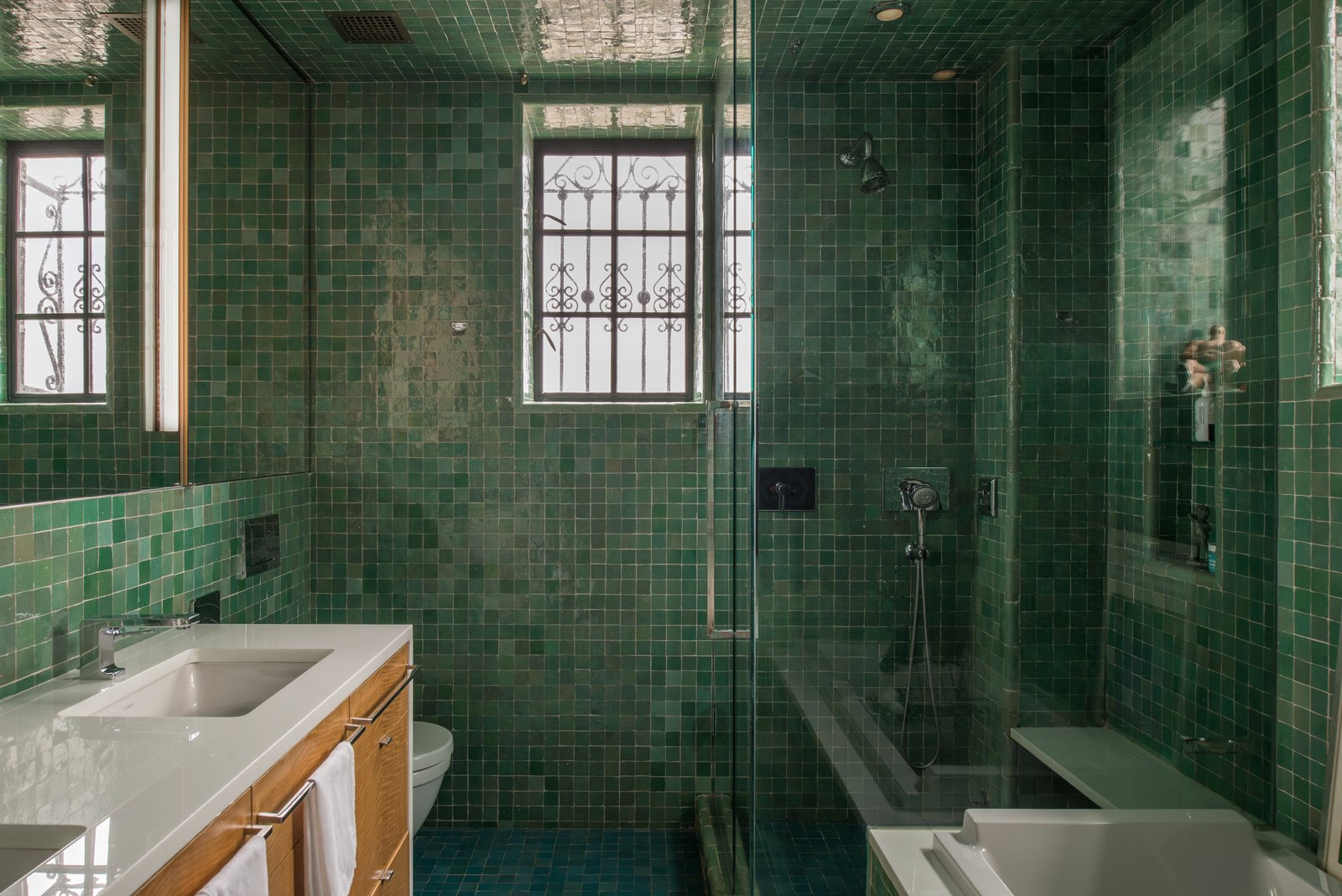 Bath Room, Drop In Sink, Engineered Quartz Counter, Drop In Tub, Enclosed Shower, Porcelain Tile Floor, and Porcelain Tile Wall  W72nd Penthouse by MUTUUS STUDIO