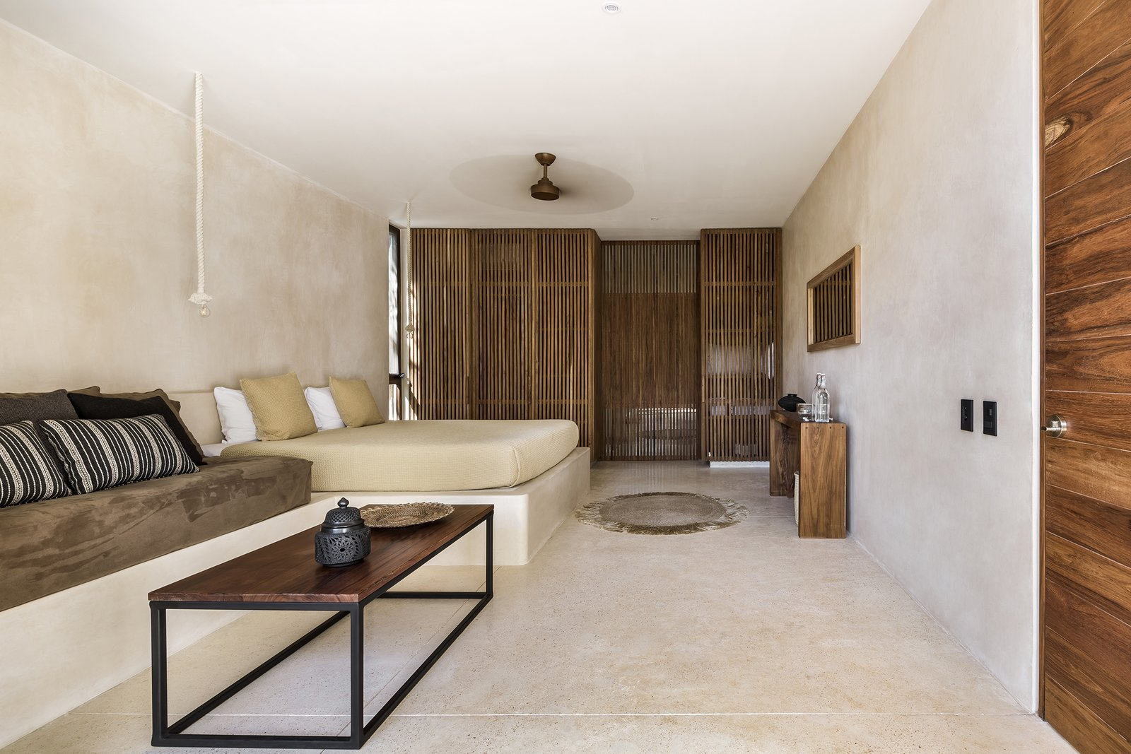 Bedroom, Concrete Floor, Bed, and Table Lighting  Photos from Jungle Keva