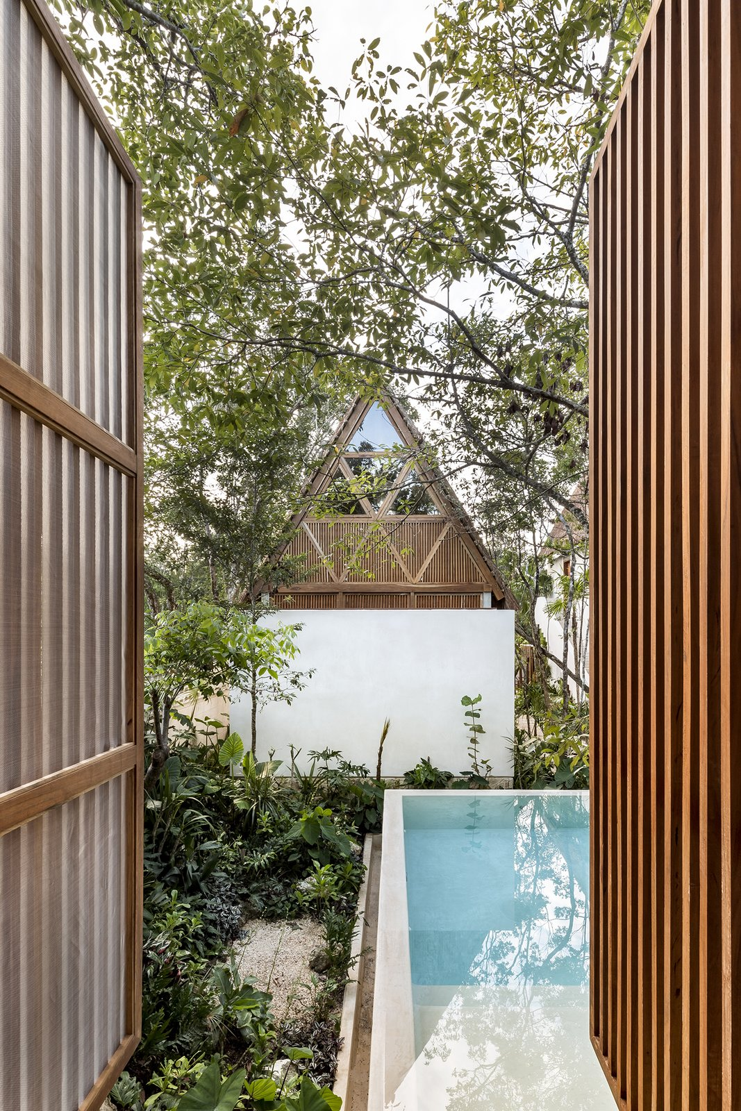 Outdoor, Wood Patio, Porch, Deck, Large Pools, Tubs, Shower, Wood Fences, Wall, Trees, Landscape Lighting, and Infinity Pools, Tubs, Shower  Jungle Keva