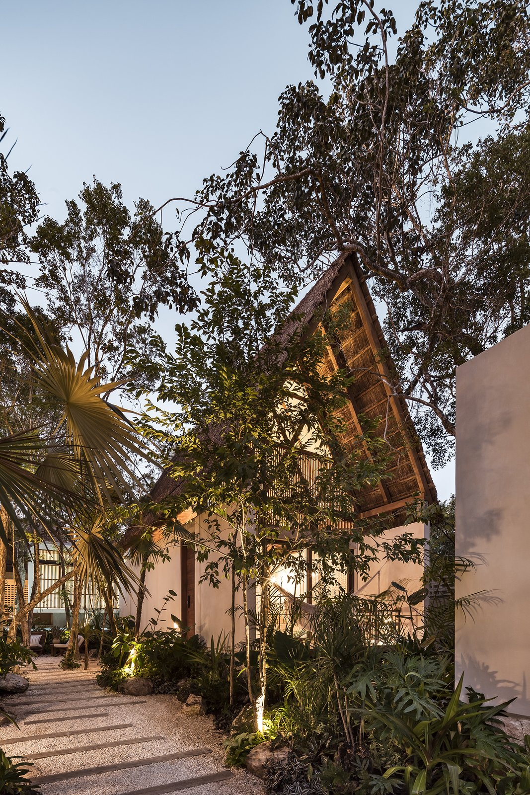 Exterior, A-Frame, Cabin, Wood, Concrete, and Stucco  Exterior A-Frame Stucco Photos from Jungle Keva