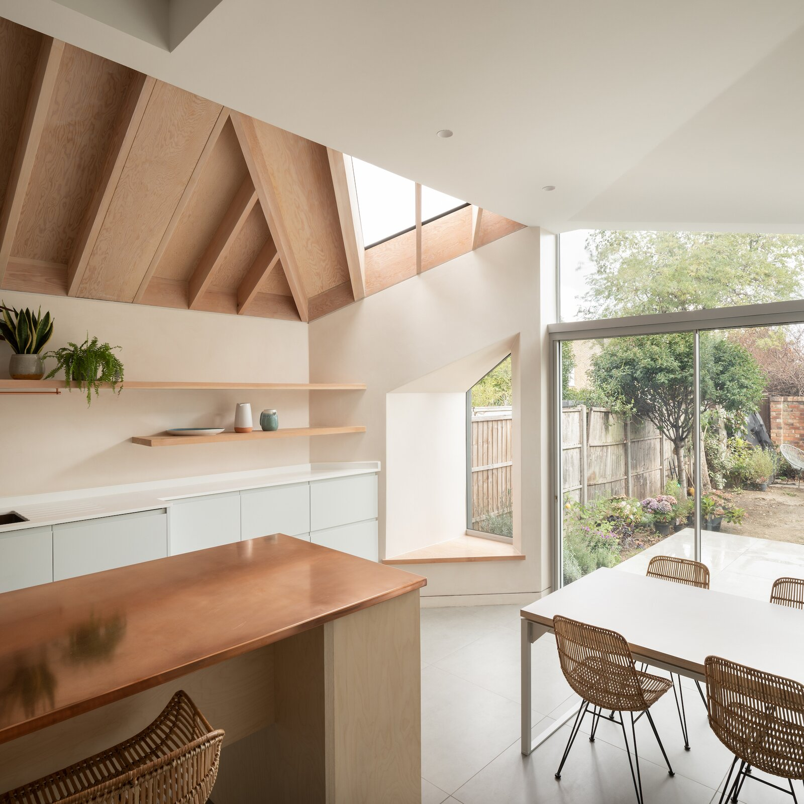 Kitchen and dining of Quarter Glass House by Proctor & Shaw.