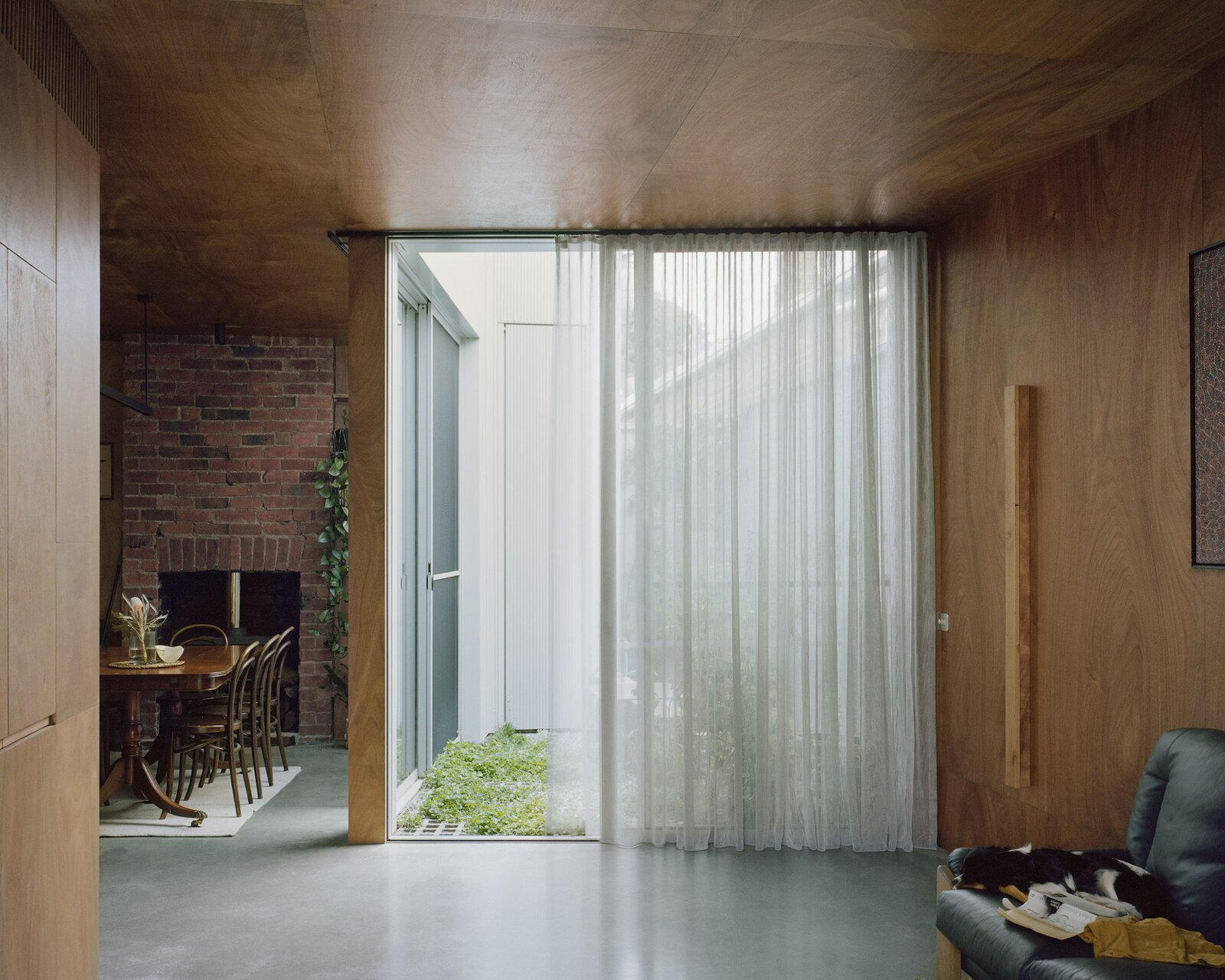 Living and dining area of Terrace House 1 by Dreamer