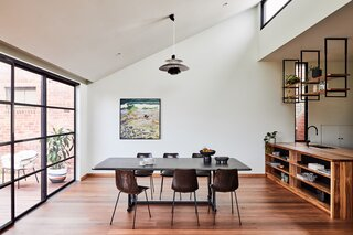 The Shiny Tile Wrapping This Melbourne Home Reflects the Greenery Around It