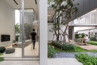A Bangkok Home's Soaring Interiors Are Set Off by a Series of Atriums