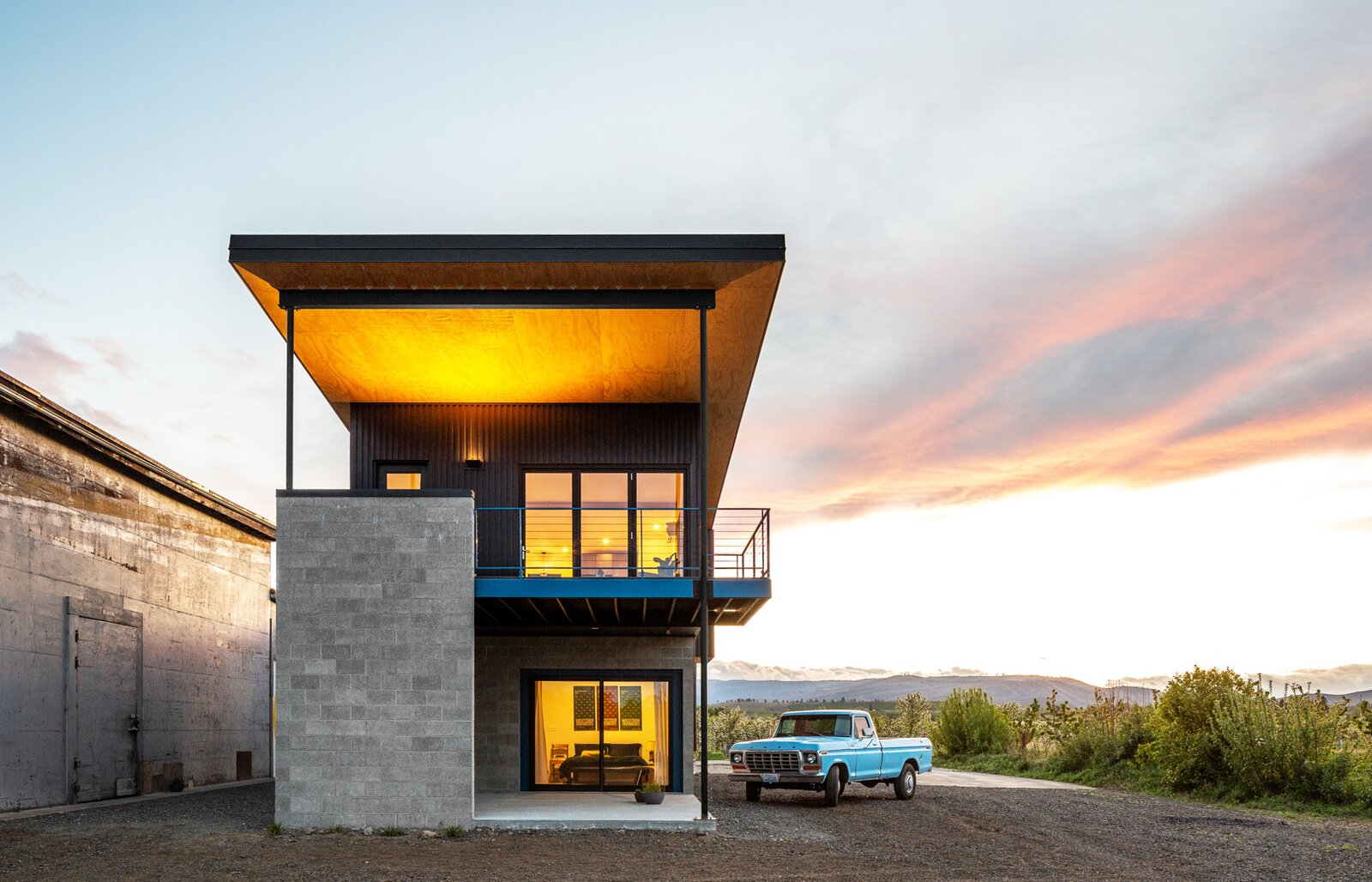 Exterior, Concrete Siding Material, Shed RoofLine, Metal Roof Material, and House Building Type  Photo 3 of 25 in An Industrial-Style Home Rises Next to a Derelict Apple-Processing Warehouse