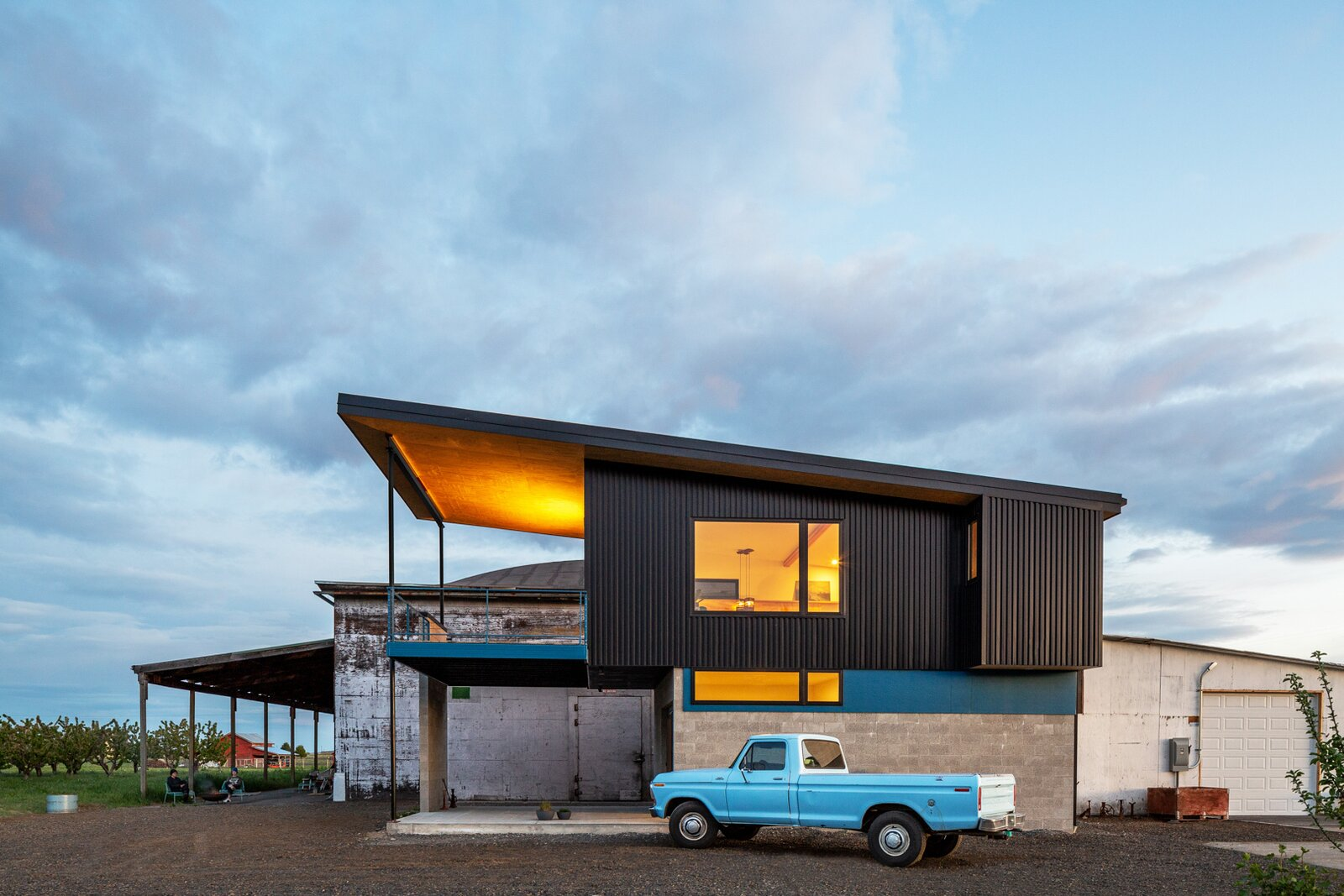 Exterior, Shed RoofLine, Metal Siding Material, Metal Roof Material, House Building Type, and Concrete Siding Material  Photo 2 of 25 in An Industrial-Style Home Rises Next to a Derelict Apple-Processing Warehouse