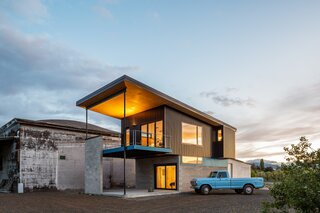 An Industrial-Style Home Rises Next to a Derelict Apple-Processing Warehouse