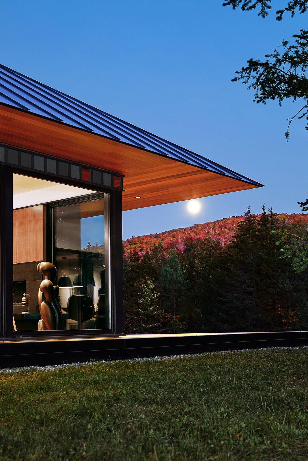 Exterior, House Building Type, Metal Roof Material, Metal Siding Material, Hipped RoofLine, and Wood Siding Material  Board & Batten by Birdseye