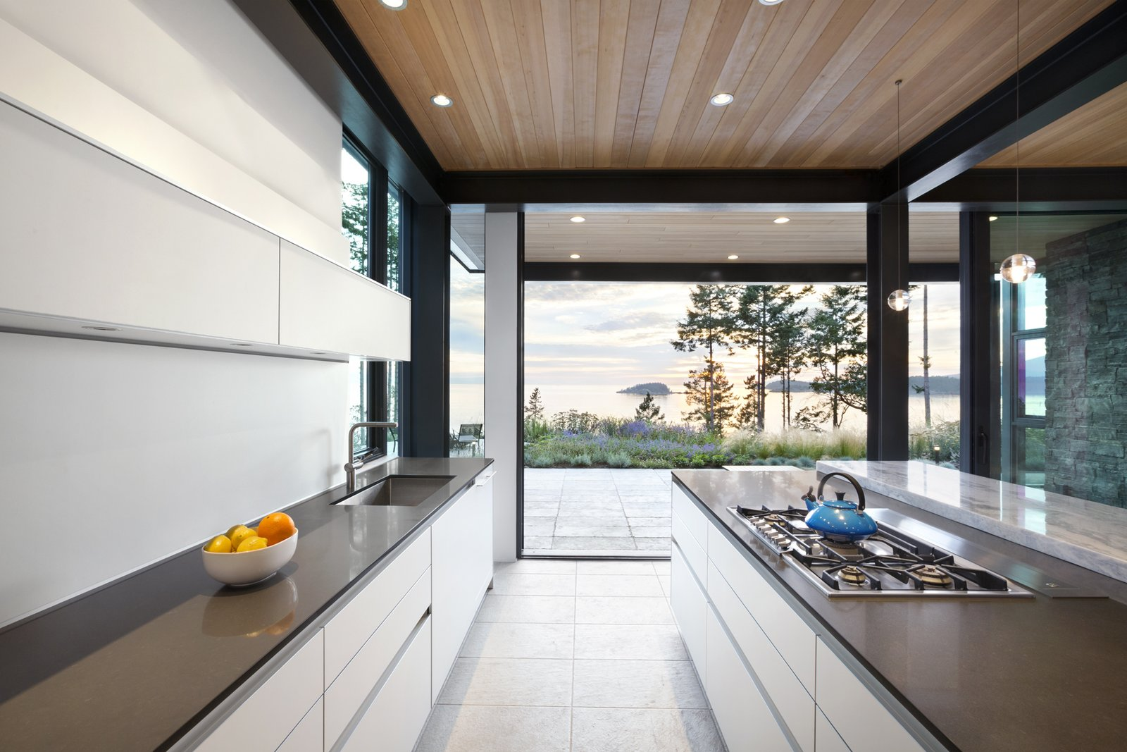 Kitchen, Engineered Quartz, Pendant, Refrigerator, White, Range, Ceiling, Wall Oven, Porcelain Tile, Dishwasher, and Undermount  Kitchen Undermount Wall Oven Porcelain Tile Photos from Collingwood Residence
