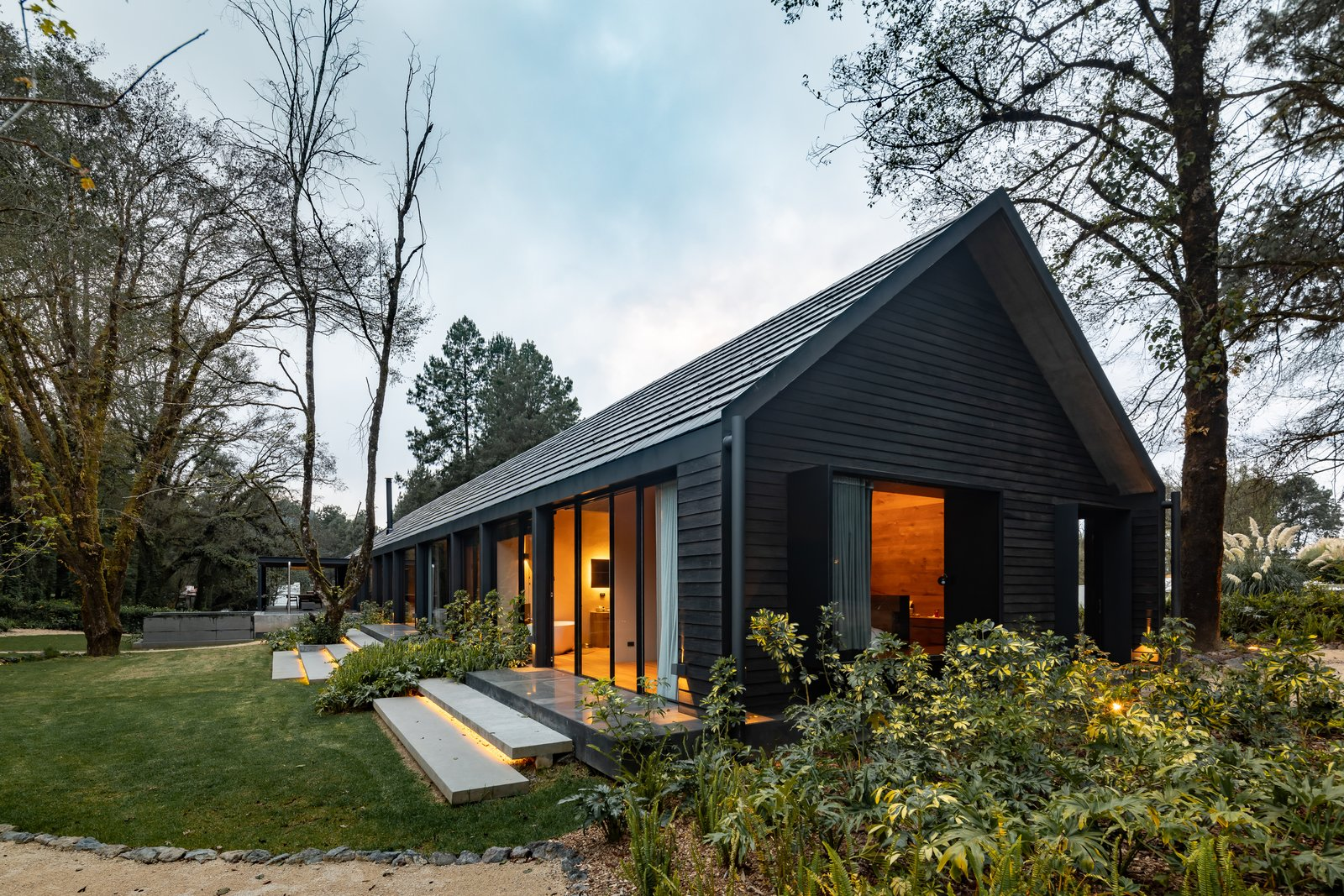Exterior, House Building Type, Tile Roof Material, Shingles Roof Material, Cabin Building Type, Wood Siding Material, A-Frame RoofLine, and Metal Siding Material  L7 Home by Augusto Fernandez