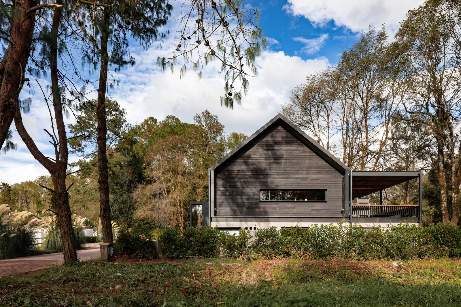 Exterior, House Building Type, A-Frame RoofLine, Tile Roof Material, Concrete Siding Material, Metal Siding Material, Shingles Roof Material, and Cabin Building Type  L7 Home by Augusto Fernandez