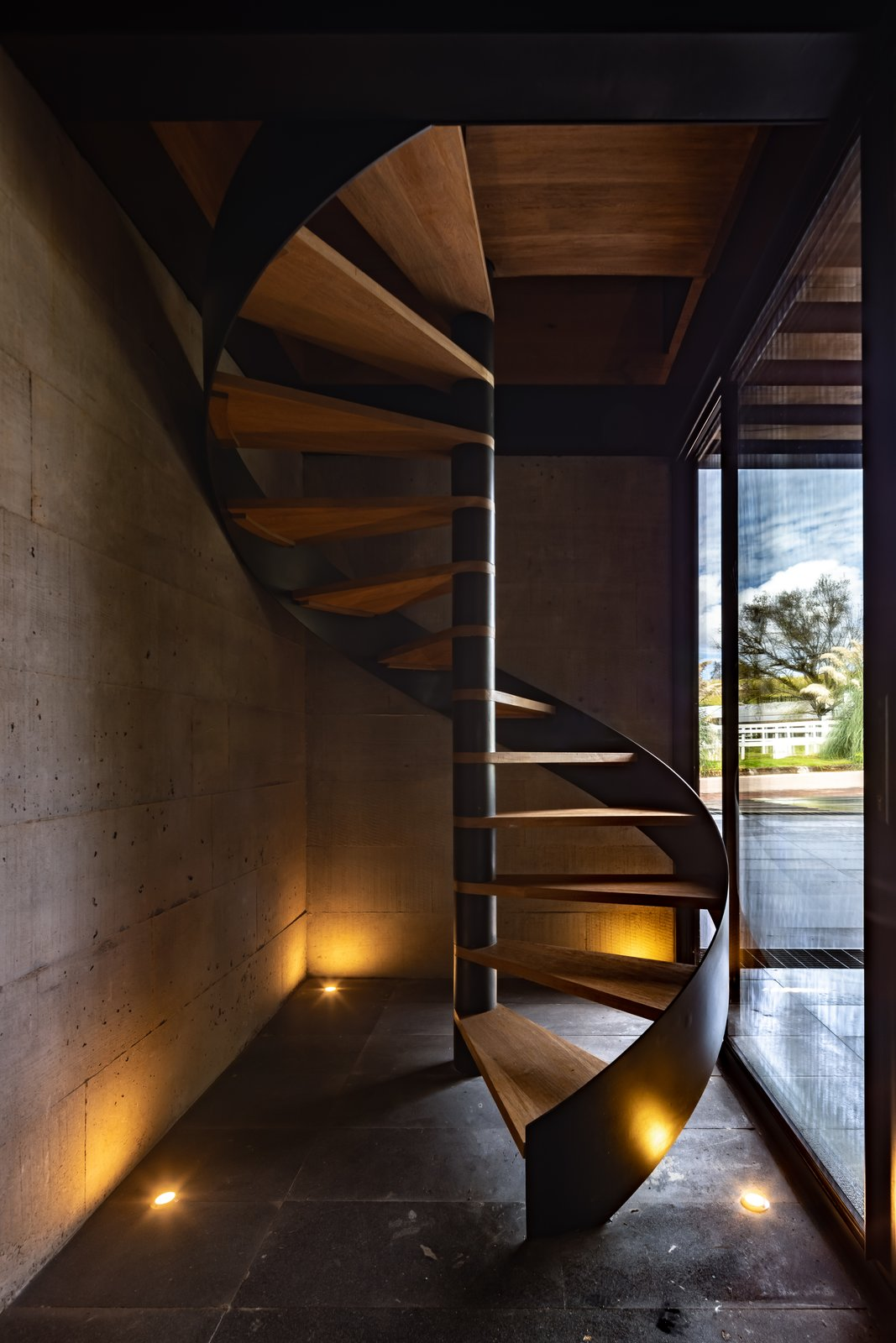 Staircase, Metal Tread, and Wood Railing  L7 Home by Augusto Fernandez