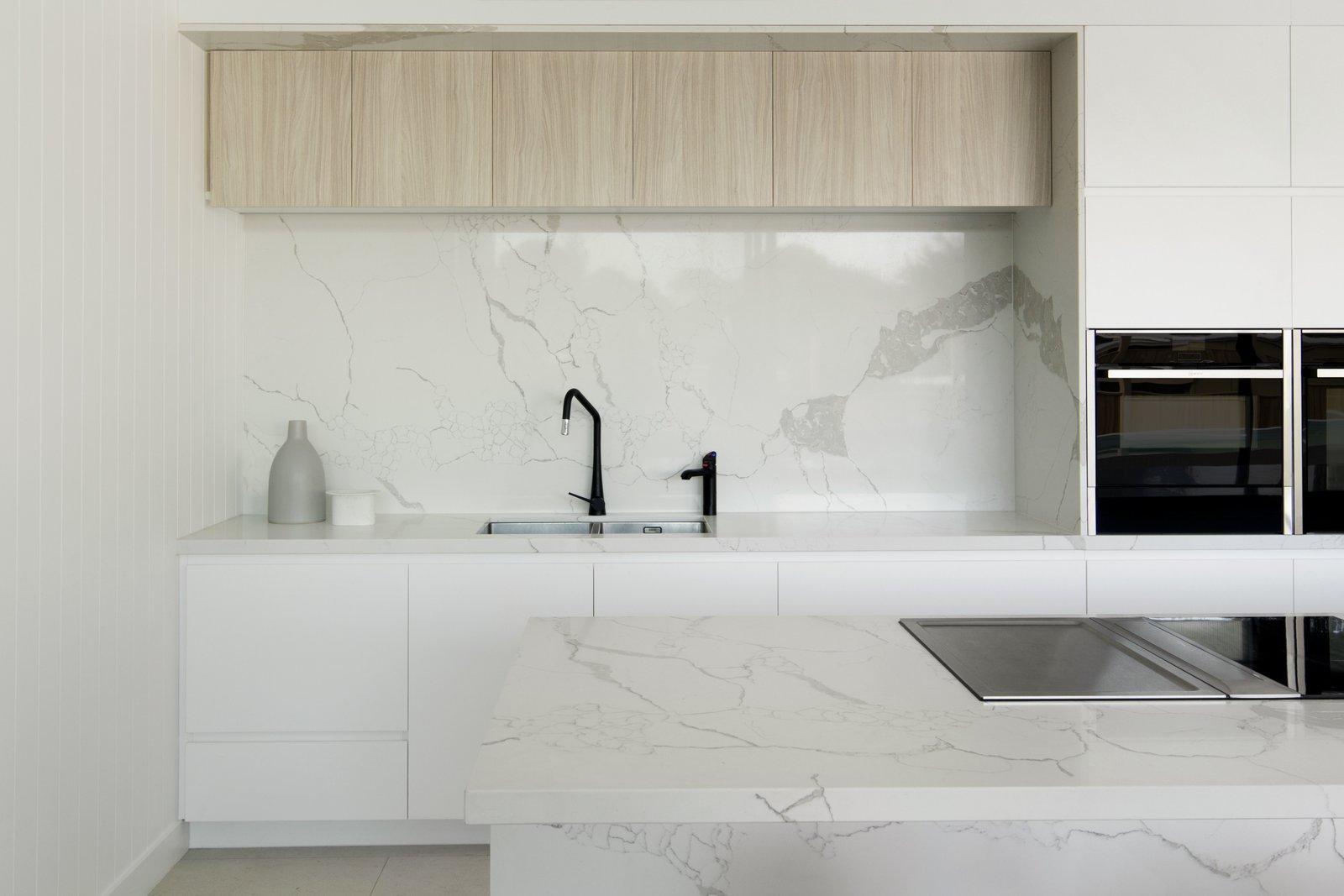 Kitchen, White, Stone Slab, Wall Oven, Ceramic Tile, Cooktops, and Stone  Kitchen Cooktops Wall Oven Ceramic Tile Stone Slab White Photos from Warraweena