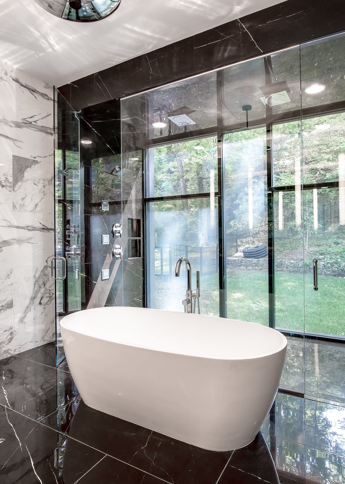 Bath Room, Marble Floor, Freestanding Tub, Marble Wall, Enclosed Shower, and Pendant Lighting  Modern View