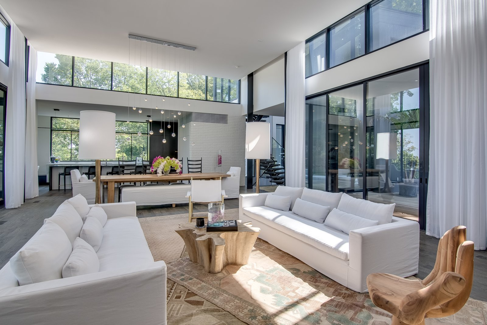 Living Room, Sofa, Pendant Lighting, Dark Hardwood Floor, Console Tables, and Chair  Modern View