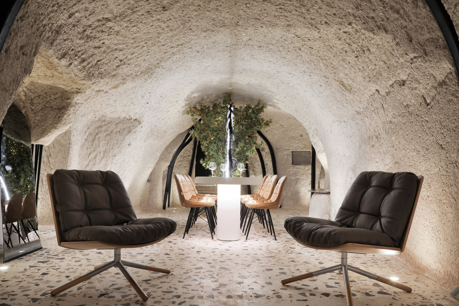 Dining Room, Chair, Table, Floor Lighting, Accent Lighting, and Terrazzo Floor  Photo 1 of 13 in A Primal Space Gets a Swanky, Modern Twist in This Turkish Cave Loft