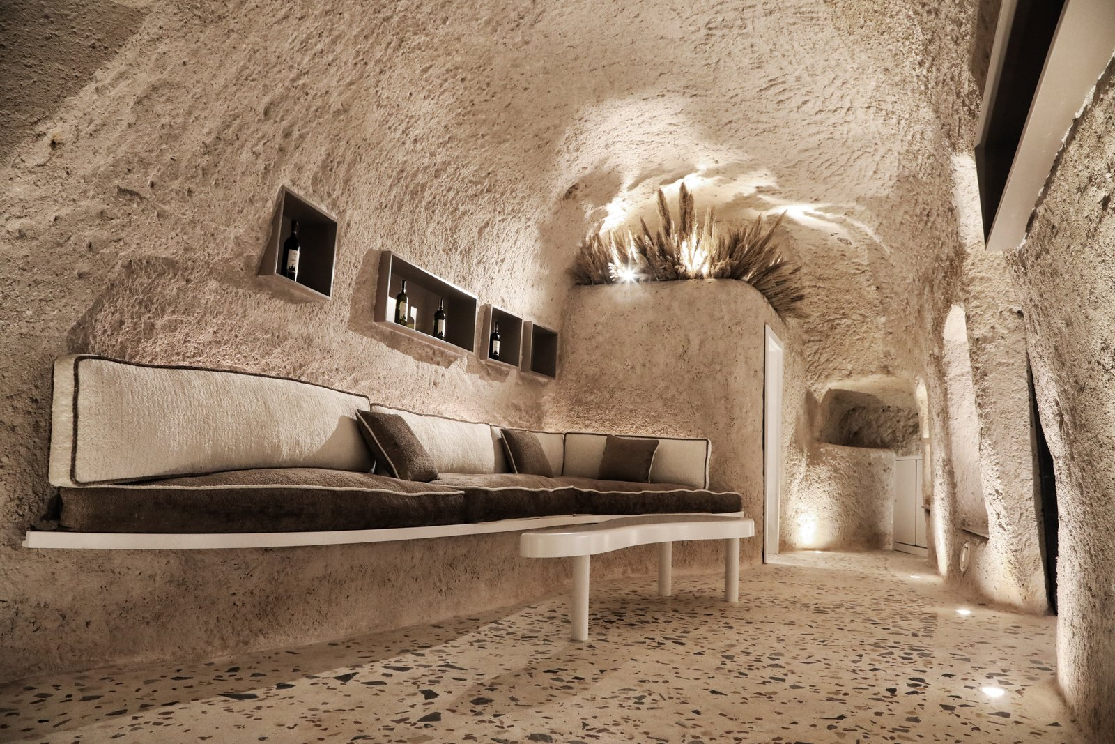 Living Room, Bench, Terrazzo Floor, Floor Lighting, and Ceiling Lighting  Photo 3 of 13 in A Primal Space Gets a Swanky, Modern Twist in This Turkish Cave Loft
