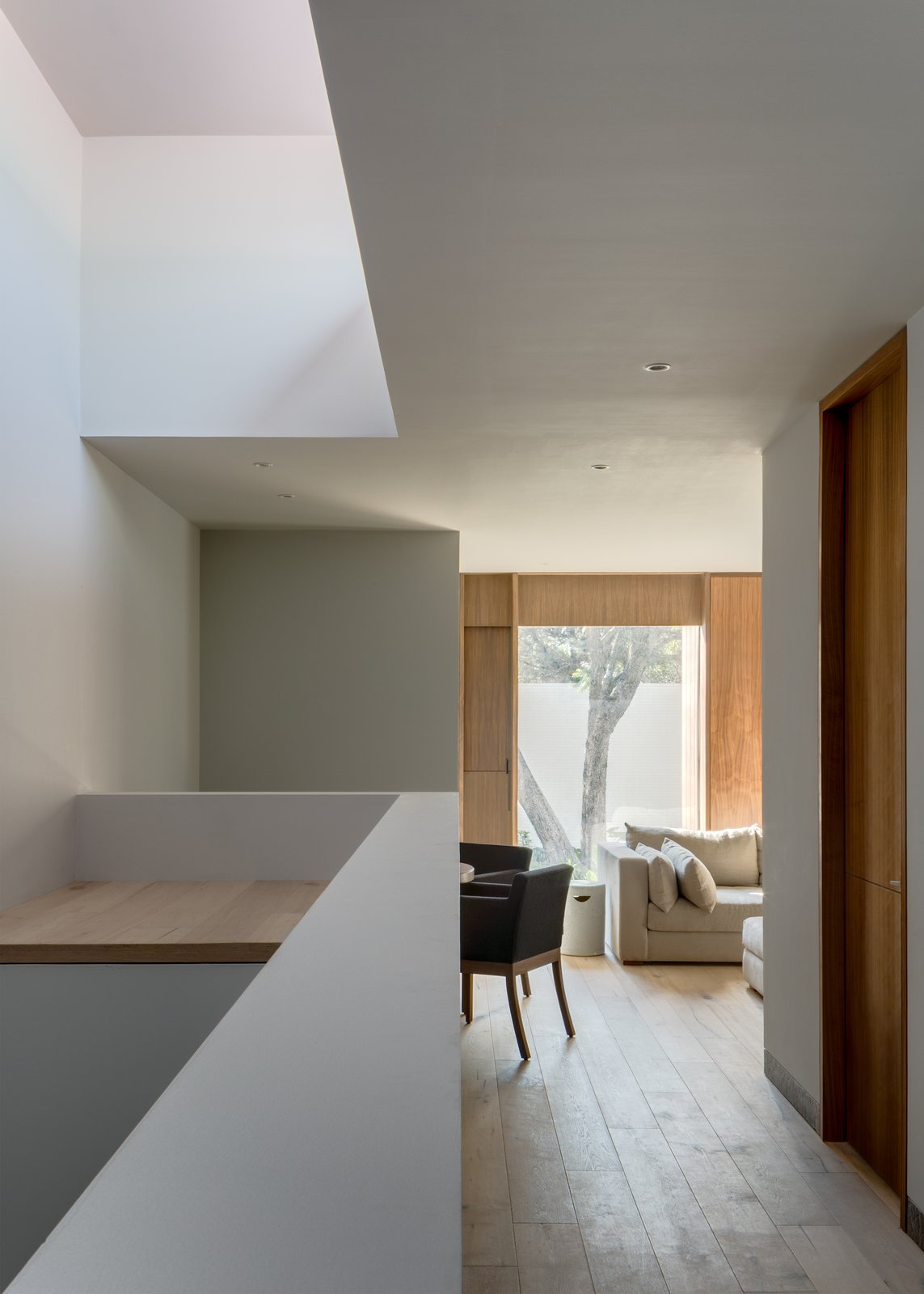 Living Room, Sofa, Recessed Lighting, Chair, and Medium Hardwood Floor  Photo 4 of 20 in A Serene Home in Mexico Weaves Around Verdant Gardens