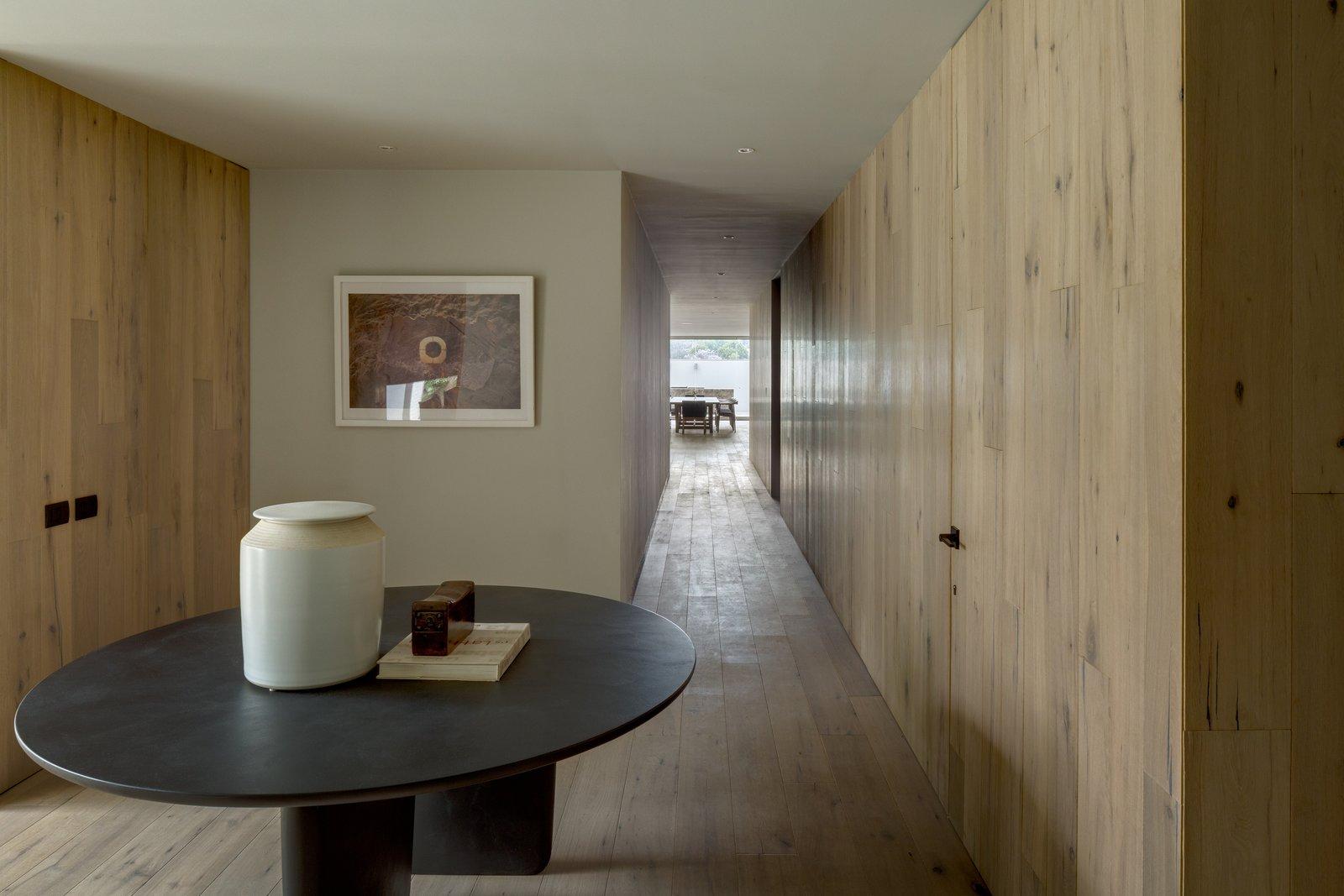 Hallway and Medium Hardwood Floor  Photo 12 of 20 in A Serene Home in Mexico Weaves Around Verdant Gardens
