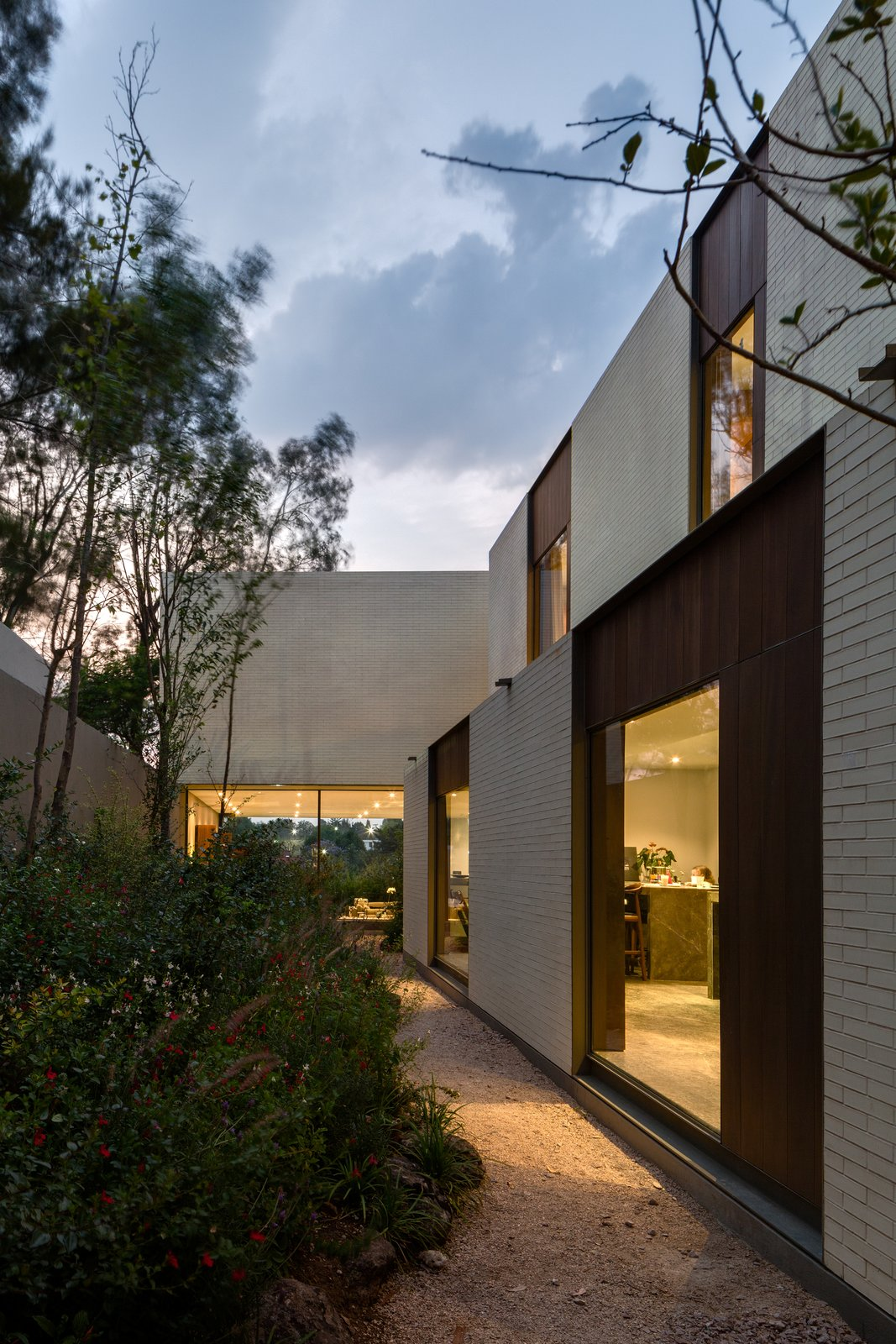 Outdoor, Garden, Hardscapes, Walkways, Flowers, Side Yard, Trees, Gardens, and Shrubs  Photo 15 of 20 in A Serene Home in Mexico Weaves Around Verdant Gardens