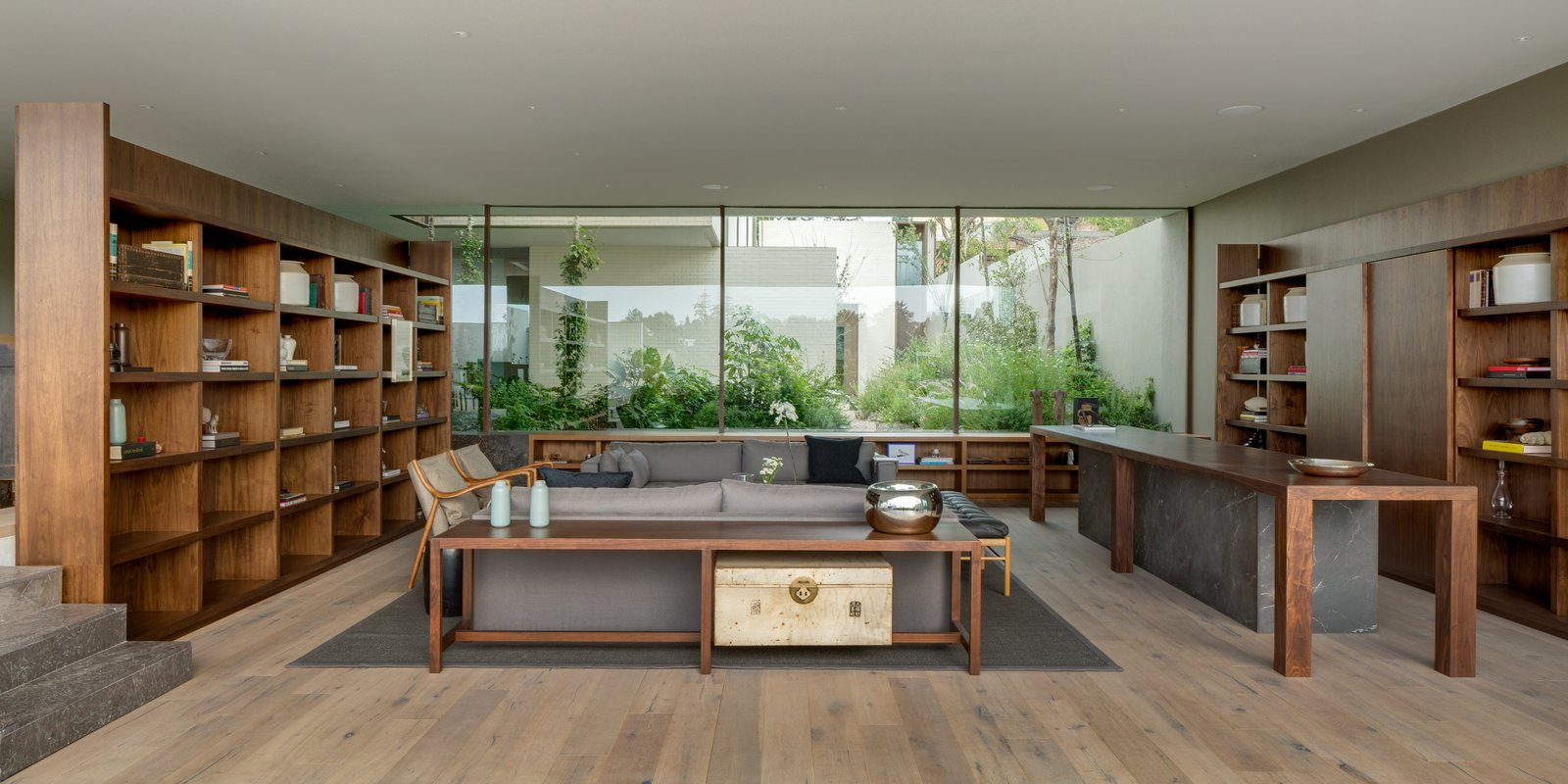 Living Room, Chair, Console Tables, Sofa, Rug Floor, Table, and Medium Hardwood Floor  Photos from A Serene Home in Mexico Weaves Around Verdant Gardens