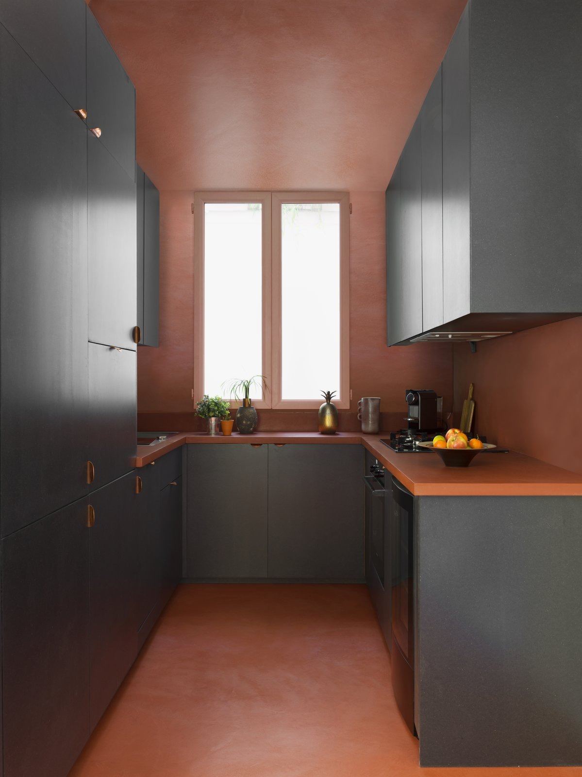 Kitchen, Wall Oven, Cooktops, Dishwasher, Concrete Floor, and Laminate Counter  Photo 6 of 12 in Street Art Meets Vintage Pieces in a Chic Parisian Renovation