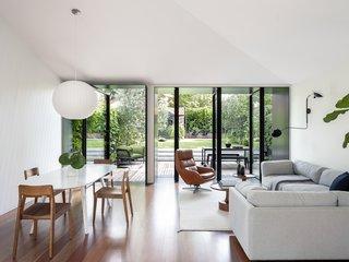 Black Pivot Doors Frame Views of This Australian Home's Verdant Garden