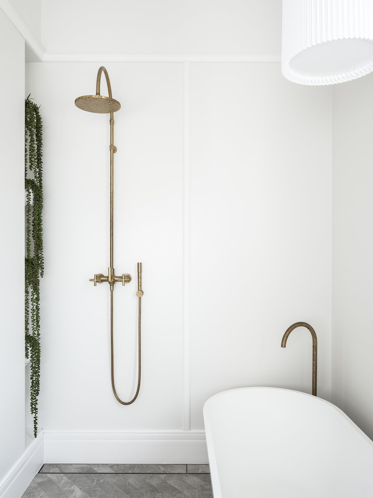 Bath, Ceramic Tile, Ceiling, Freestanding, Pendant, Open, and Accent  Bath Pendant Accent Photos from Black Pivot Doors Frame Views of This Australian Home's Verdant Garden