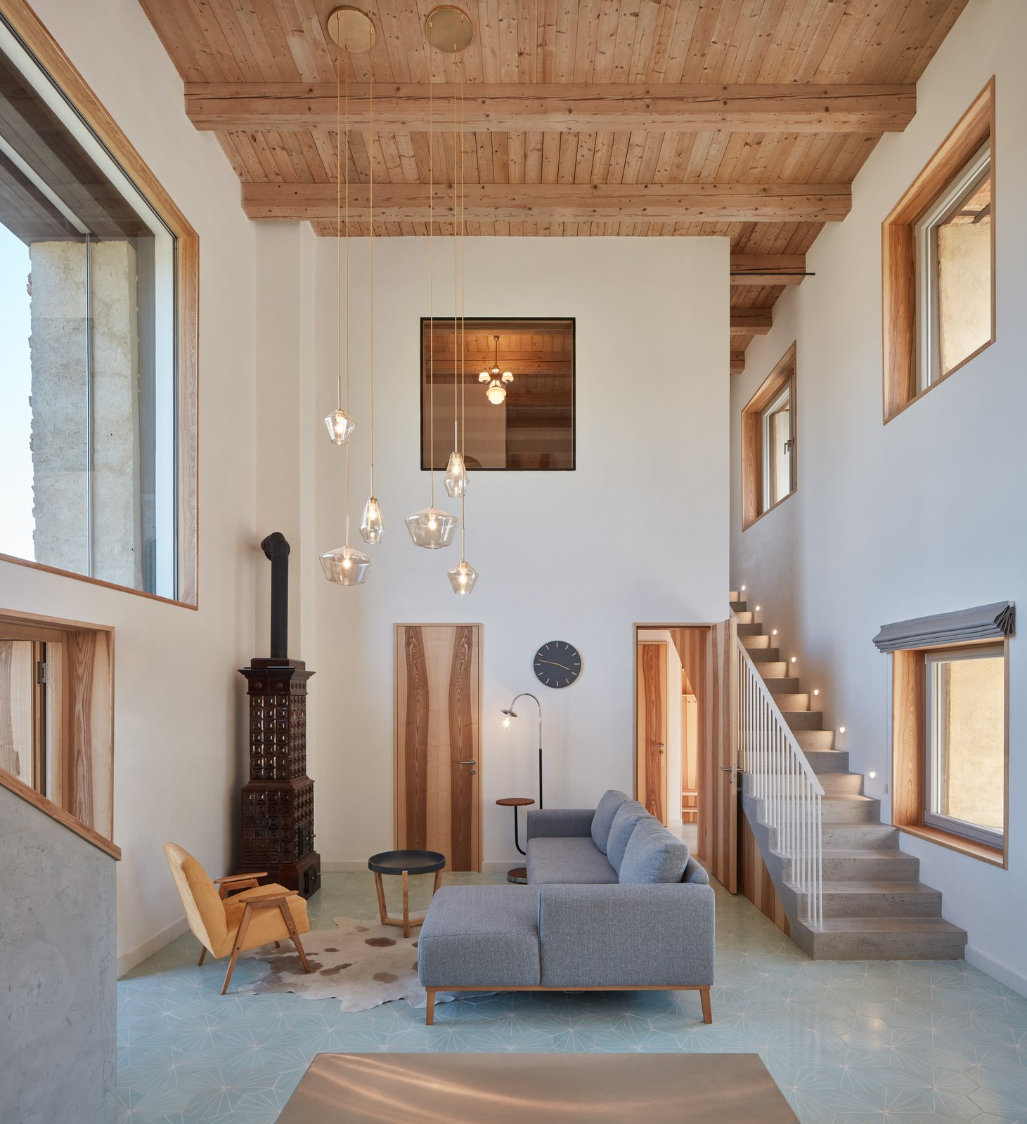 Living, Chair, Hanging, Sofa, End Tables, Coffee Tables, Rug, Ceiling, Lamps, and Sectional  Living Sectional Lamps Photos from Romantic Ruins Enclose a Modern House in the Czech Republic