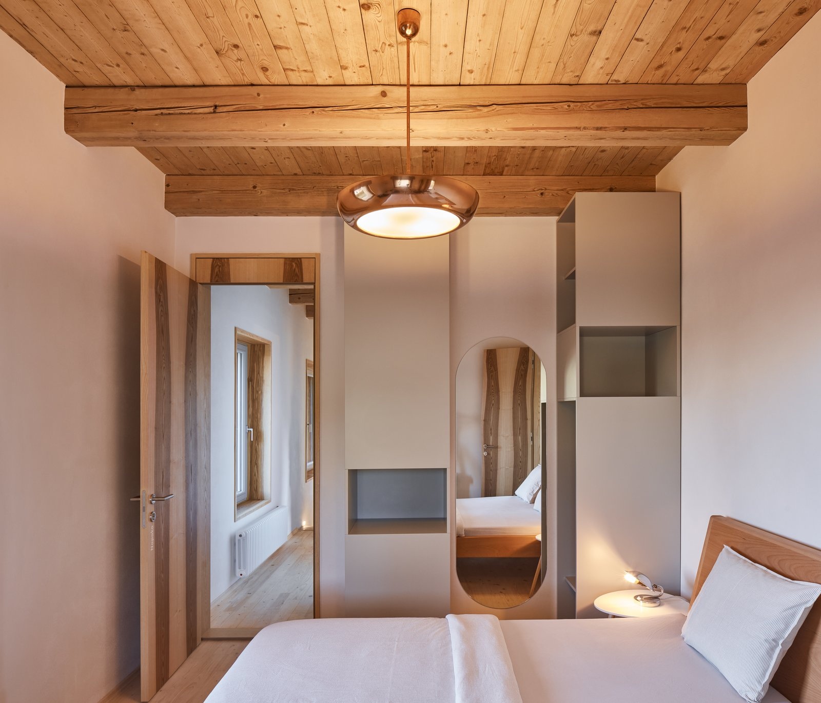 Bedroom, Bed, Night Stands, Light Hardwood Floor, Ceiling Lighting, and Pendant Lighting  Photo 11 of 23 in Romantic Ruins Enclose a Modern House in the Czech Republic