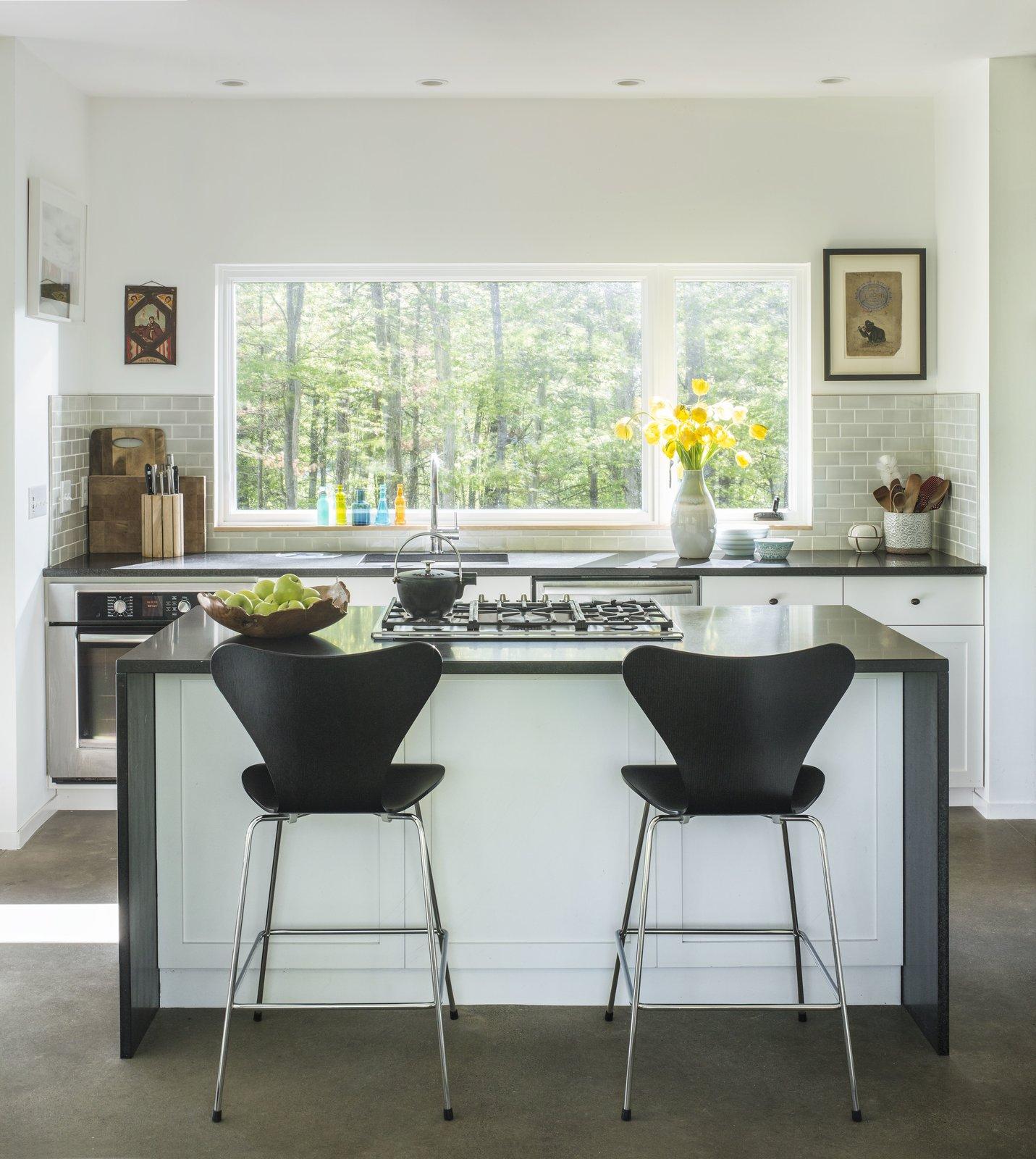 Kitchen, Engineered Quartz, Subway Tile, Cooktops, Range, Concrete, Dishwasher, Wall Oven, Ceramic Tile, and White  Kitchen Range Subway Tile Photos from Knoll House