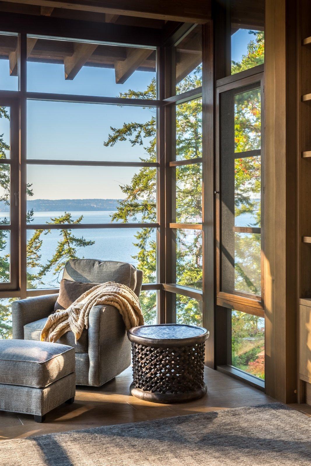 Living Room, Medium Hardwood Floor, Chair, Ottomans, and End Tables  Kayak Point