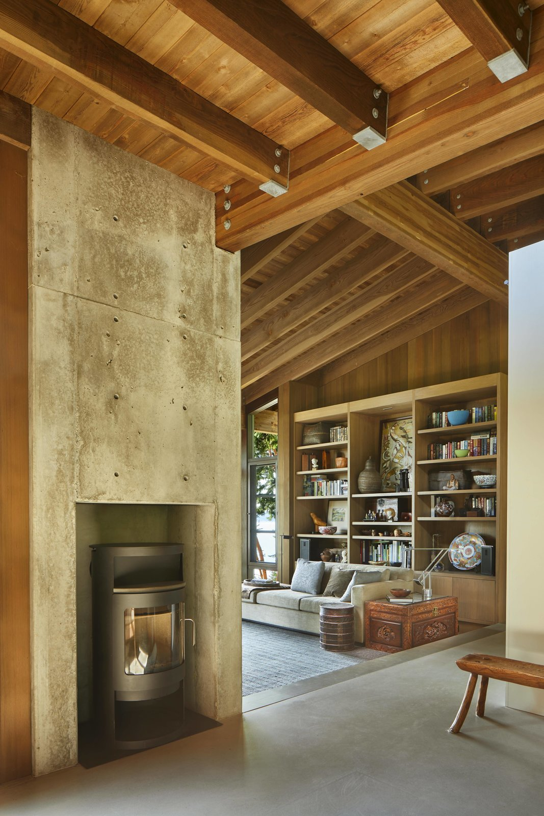 Living Room, Bench, Concrete Floor, Standard Layout Fireplace, Sofa, Medium Hardwood Floor, and Corner Fireplace  Kayak Point