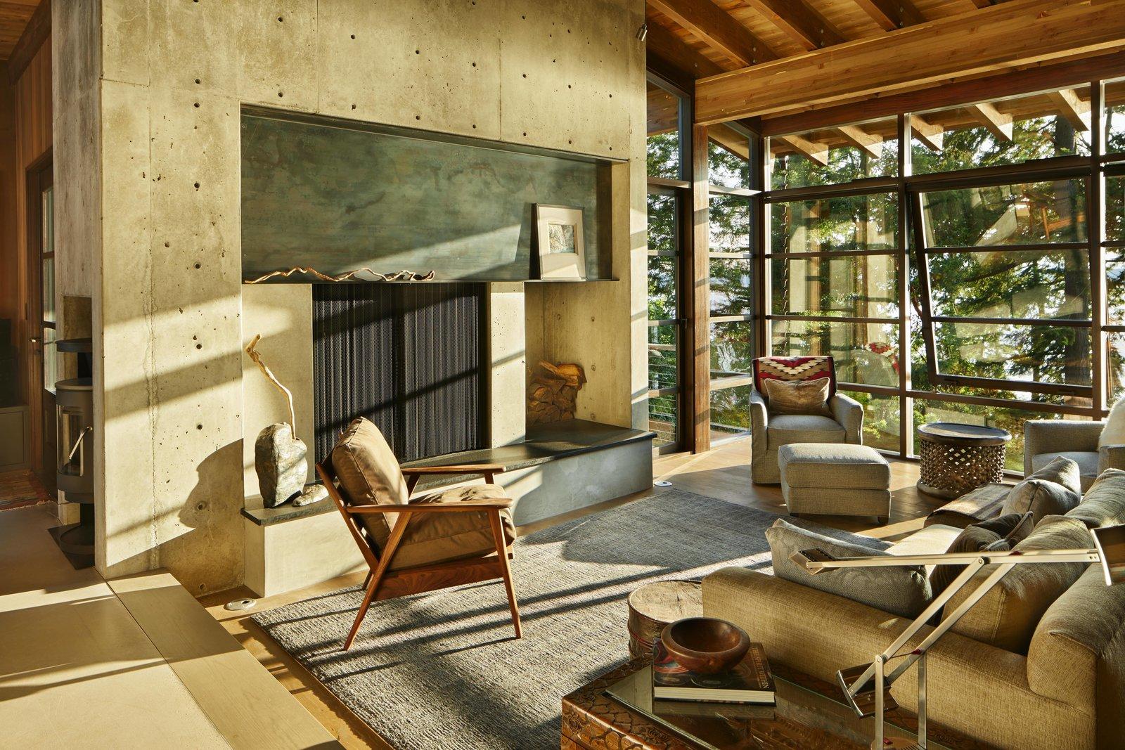 Living Room, Chair, Sofa, Medium Hardwood Floor, Standard Layout Fireplace, Bench, and Corner Fireplace  Kayak Point
