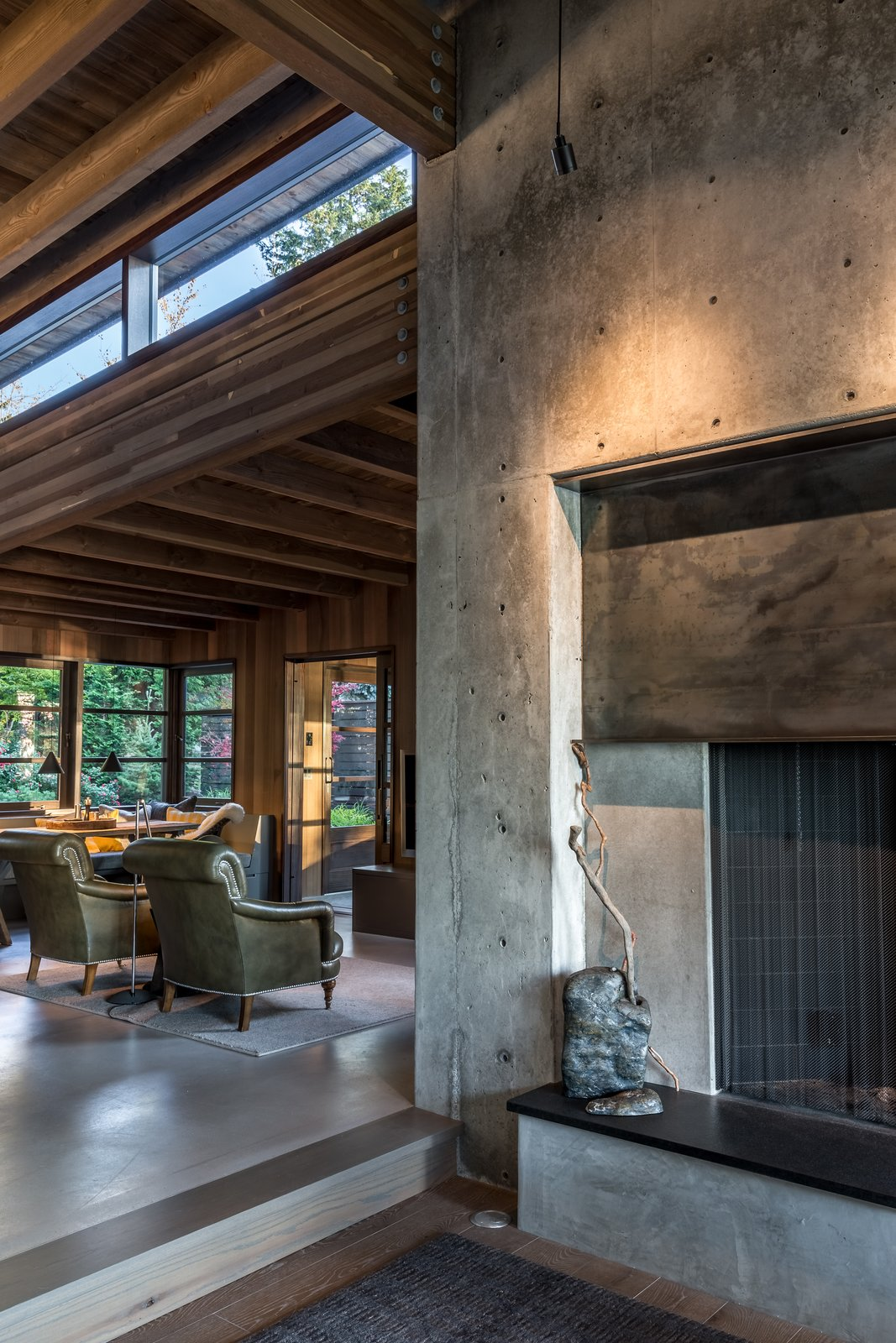 Living Room, Wood Burning Fireplace, Concrete Floor, Corner Fireplace, and Chair  Kayak Point