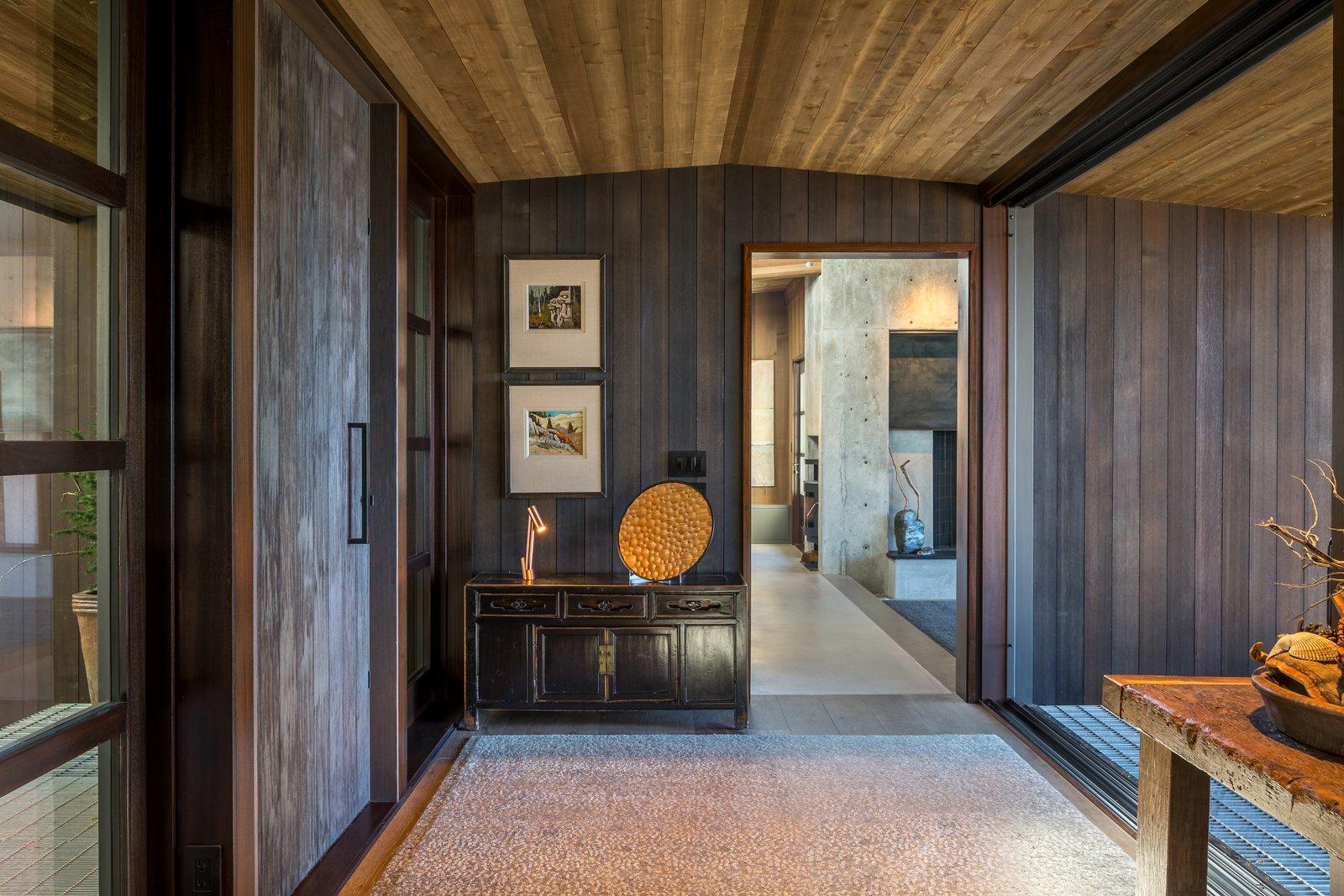 Hallway, Dark Hardwood Floor, and Rug Floor  Kayak Point