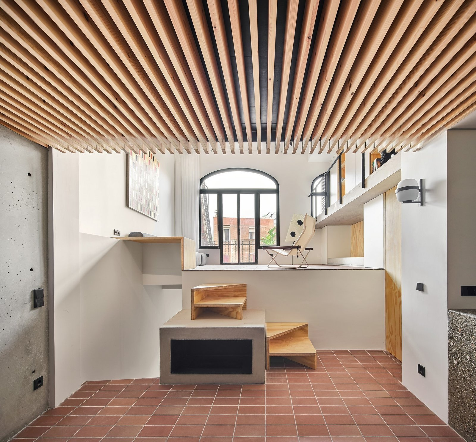Kitchen, Ceramic Tile Floor, and Wall Lighting  Photo 8 of 15 in A Renovation Turns a Once-Abandoned Barcelona Building Into an Airy Home