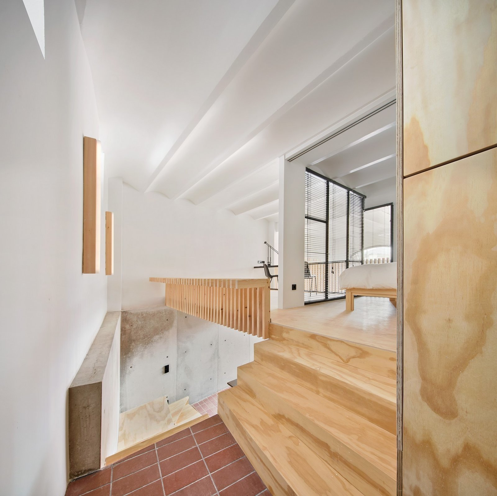 Staircase and Wood Tread  Photo 7 of 15 in A Renovation Turns a Once-Abandoned Barcelona Building Into an Airy Home