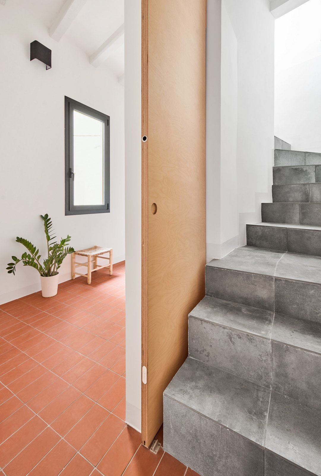 Staircase and Stone Tread  Photo 14 of 17 in Picture Windows and Sliding Doors Work Magic in This Cozy Barcelona Home